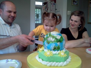 mommy's happy, cake is awesome, Lilly holds a knife. With help. YIKES!